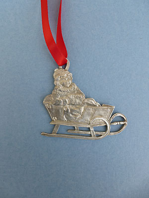 Girl in Sleigh Christmas Ornament - Lead Free Pewter