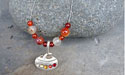Curling Rock with Rhinestones Beaded Pendant - Lead Free Pewter